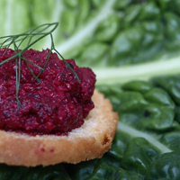 Beetroot based canape served on a cabbage leaf