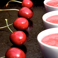 Cherry gazpacho served in small white espreso cups