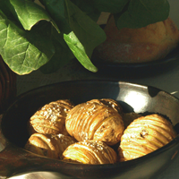 Hasselbacks potatoes in a brown bowl