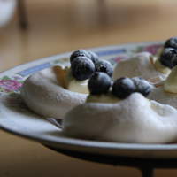 Delicious blueberry pavlovas on a tray